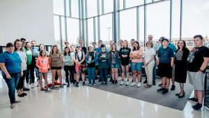 The Joplin Globe covers the first graduation of middle schoolers from Compass Academy